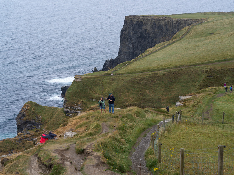 Tourists at Cliffs of Moher, Atlantic Ocean, Ennistimon, County Clare, Republic of Ireland