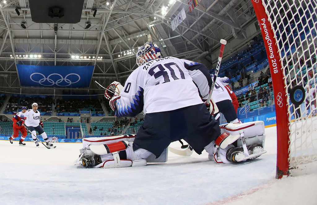 . The puck shot by Jan Kolar (29), of the Czech Republic, sails past goalie Ryan Zapolski (30), of the United States, for a goal during the first period of the quarterfinal round of the men\'s hockey game at the 2018 Winter Olympics in Gangneung, South Korea, Wednesday, Feb. 21, 2018. (Ronald Martinez/Pool Photo via AP)