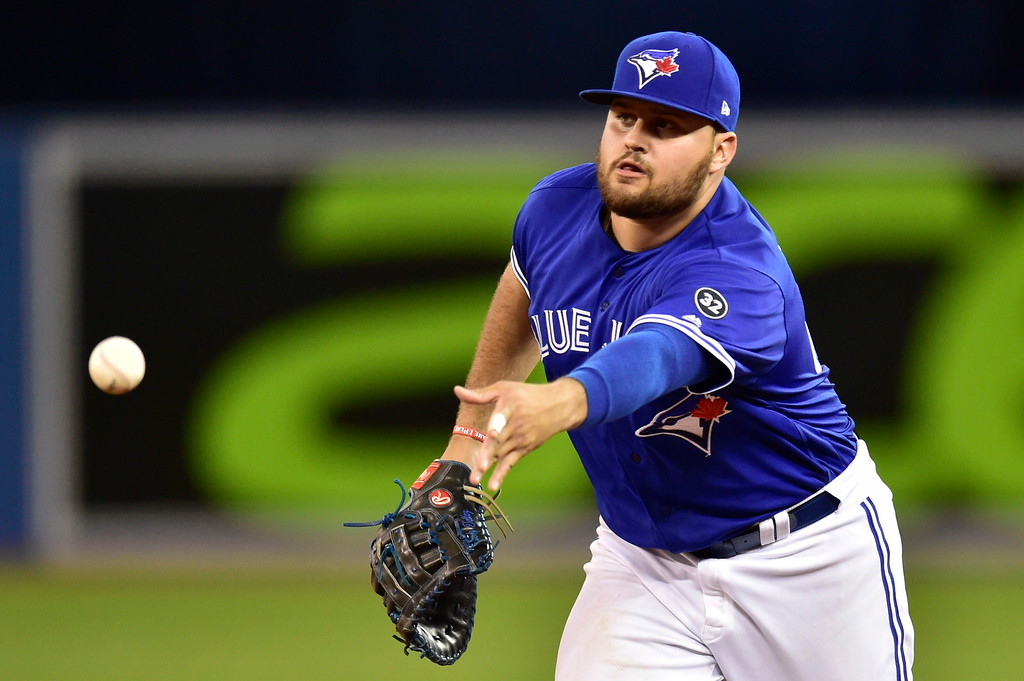 . Toronto Blue Jays\' Rowdy Tellez throws to relief pitcher Ken Giles for the out on Cleveland Indians\' Greg Allen during the ninth inning of a baseball game Friday, Sept. 7, 2018, in Toronto. (Frank Gunn/The Canadian Press via AP)