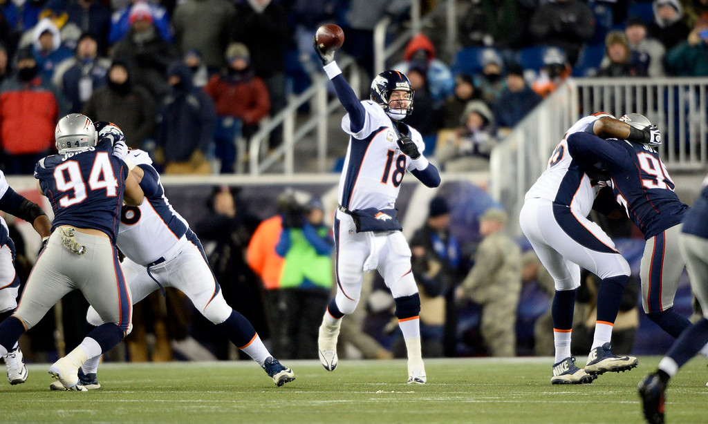 . Denver Broncos quarterback Peyton Manning (18) drops back to pass against the New England Patriots during the first quarter November 24, 2013 at Gillette Stadium. (Photo by John Leyba/The Denver Post)