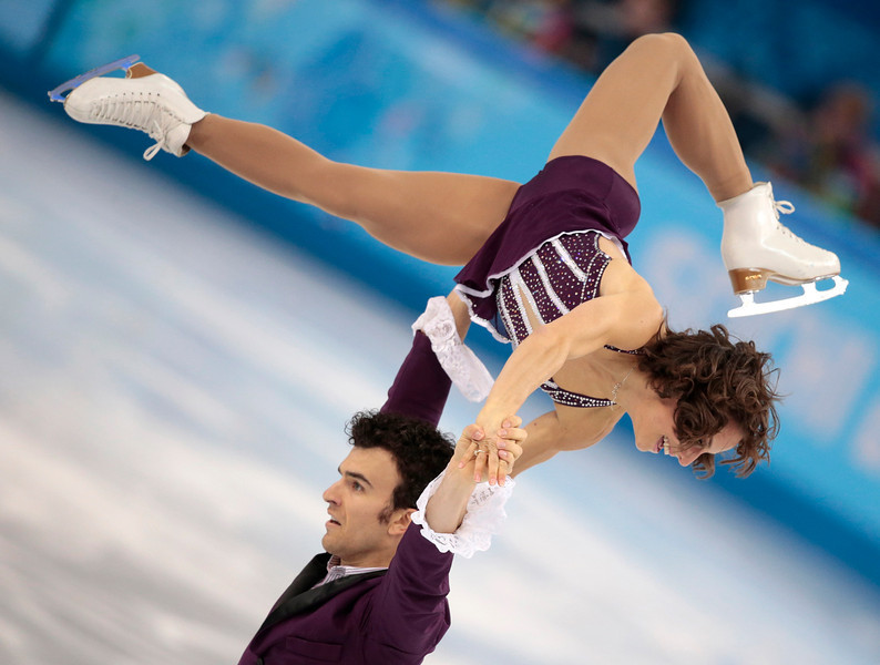 . Meagan Duhamel and Eric Radford of Canada compete in the pairs free skate figure skating competition at the Iceberg Skating Palace during the 2014 Winter Olympics, Wednesday, Feb. 12, 2014, in Sochi, Russia. (AP Photo/Ivan Sekretarev)