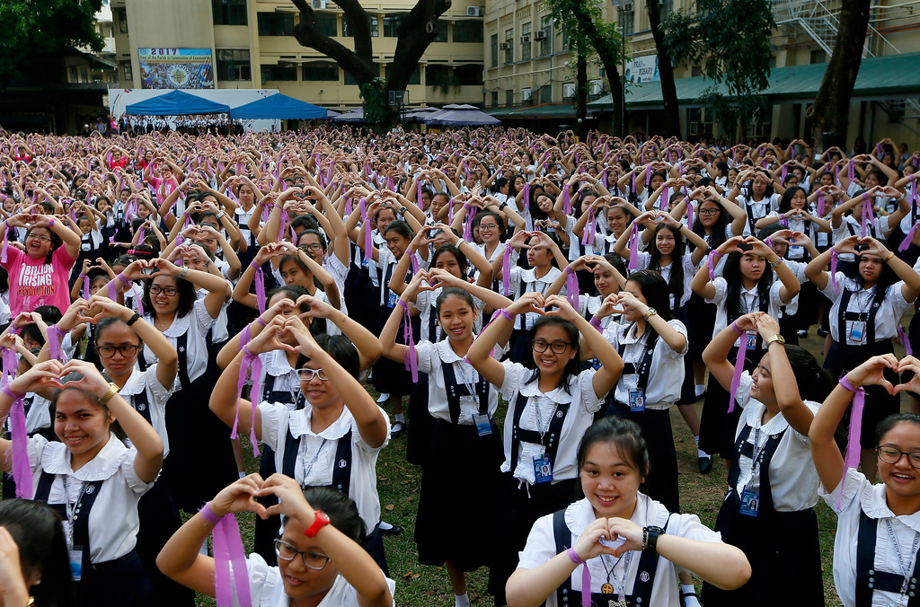 ". Students from the Catholic-run St. Scholastica\'s College form a heart symbol to celebrate Valentine\'s Day following a mass dancing dubbed ""One Billion Rising\"" Tuesday, Feb. 14, 2017 in Manila, Philippines. The annual mass dancing in their campus was to draw the attention on the global problem on violence against women and children. (AP Photo/Bullit Marquez)"