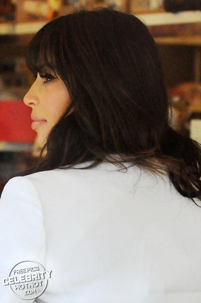 Pregnant Kim Kardashian Has Bangs And Shops for Baby Clothes, LA
