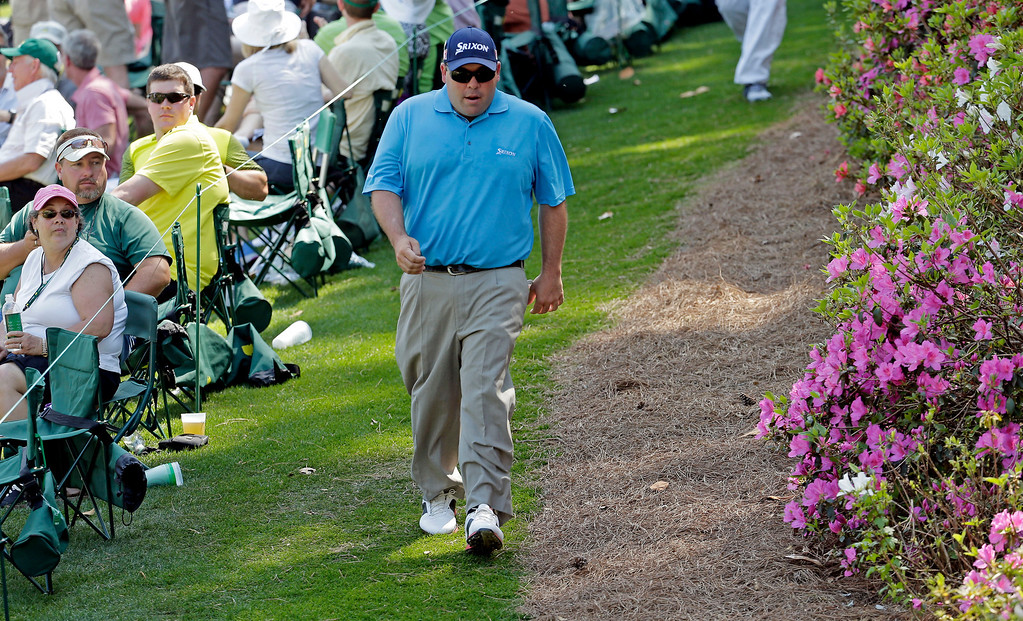 . Kevin Stadler walks down the sixth fairway during the third round of the Masters golf tournament Saturday, April 12, 2014, in Augusta, Ga. (AP Photo/Charlie Riedel)
