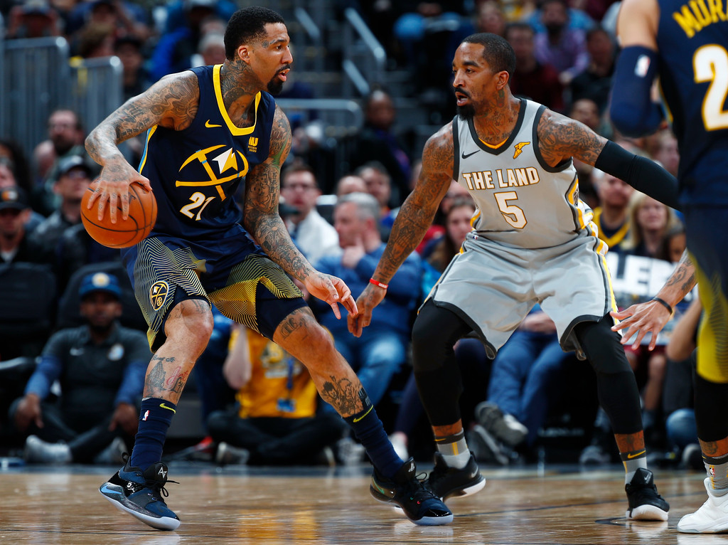 . Denver Nuggets forward Wilson Chandler, left, looks to drive to the basket as Cleveland Cavaliers guard JR Smith defends during the first half of an NBA basketball game Wednesday, March 7, 2018, in Denver. (AP Photo/David Zalubowski)