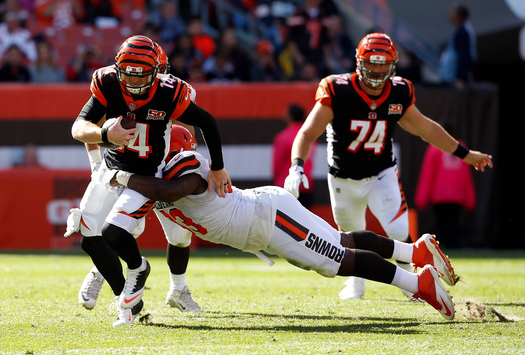 . Cincinnati Bengals quarterback Andy Dalton (14) is tackled by Cleveland Browns defensive tackle Trevon Coley (93) in the second half of an NFL football game, Sunday, Oct. 1, 2017, in Cleveland. (AP Photo/Ron Schwane)