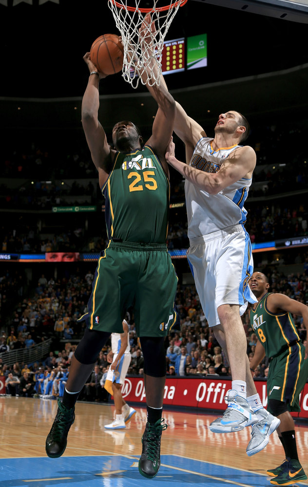 . Al Jefferson #25 of the Utah Jazz grabs a rebound away from Kosta Koufos #41 of the Denver Nuggets at the Pepsi Center on January 5, 2013 in Denver, Colorado. (Photo by Doug Pensinger/Getty Images)