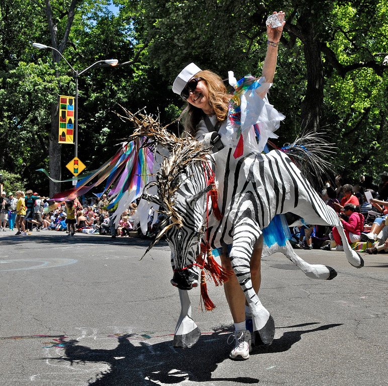 """. Jeff Forman/JForman@News-Herald.com Dyane Hanslik rides a zebra in the museum\'s \""""Mix it Up\"""" entry in the Cleveland Museum of Art 25th annual Parade the Circle June 14 in University Circle."""