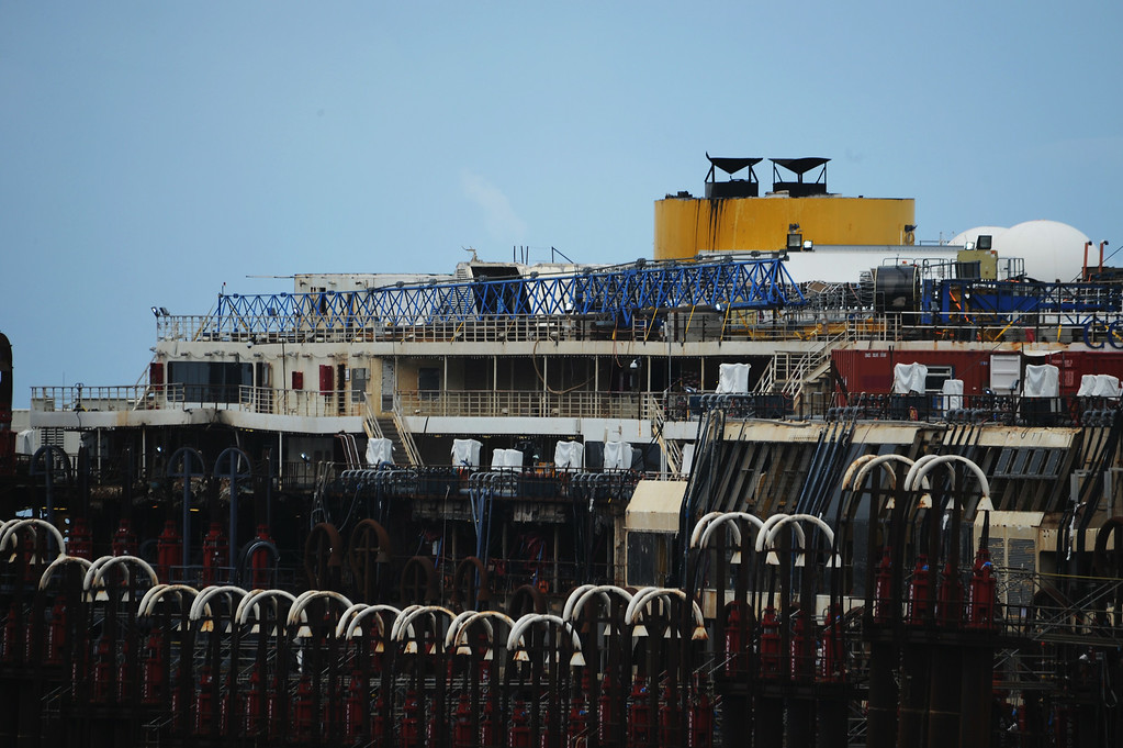 . The wrecked ship Costa Concordia is seen after the succesfully refloating operations on July 14, 2014 in Isola del Giglio, Italy. On the first day of the operation the wreck will be partially refloated by 2 metres from the platfoms that support it and will be moved approximately 30 metres to the east. The wreck will then be kept in position by tugs and moored by anchors aft, with steel cables. The refloating operation is expected to take up to a week before being towed to the port of Genoa for dismantling.  (Photo by Laura Lezza/Getty Images)