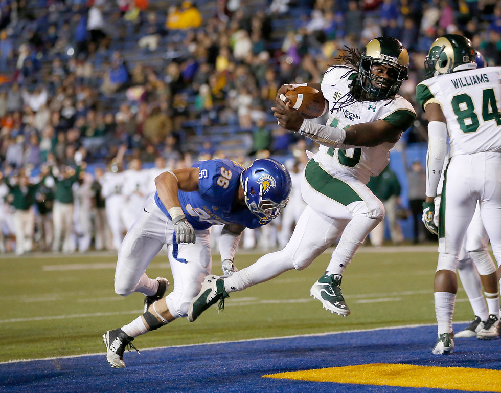 . Colorado State running back Dee Hart (10) runs into the end zone for a touchdown past San Jose State linebacker Vince Buhagiar (36) during the second half of an NCAA college football game Saturday, Nov. 1, 2014, in San Jose, Calif. (AP Photo/Tony Avelar)