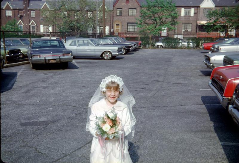 pat in communion dress in parking lot.jpg