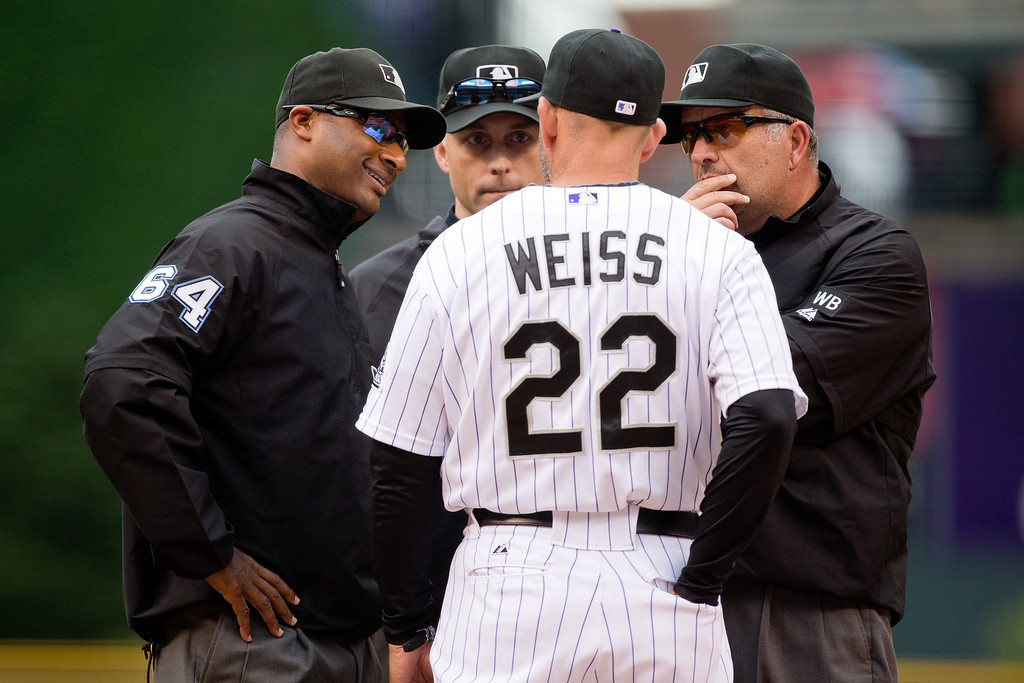 . Manager Walt Weiss #22 of the Colorado Rockies discusses a call with umpires (from left) Alan Porter, Dan Iassogna and Dale Scott during the first inning against the Los Angeles Dodgers at Coors Field on June 8, 2014 in Denver, Colorado. (Photo by Justin Edmonds/Getty Images)