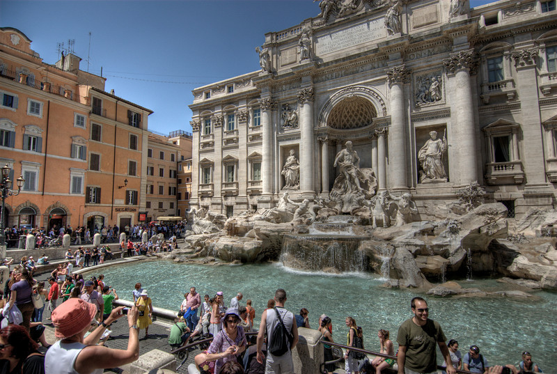 Tourists taking a picture of the Trevi Fountain in Rome, Italy