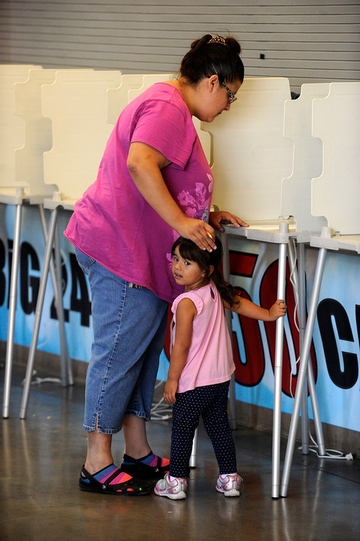 . PUEBLO, CO. - SEPTEMBER 10: Mariposa Valdez, age 3, waited while her mother Kimberly cast her ballot in the recall election at the Colorado State Fairgrounds Tuesday afternoon, September 10, 2013. State Senator Angelo Giron faces a recall in District 3. Photo By Karl Gehring/The Denver Post