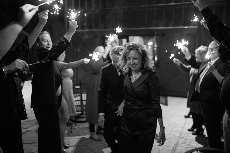 Bride exiting the sparkler tunnell.jpg