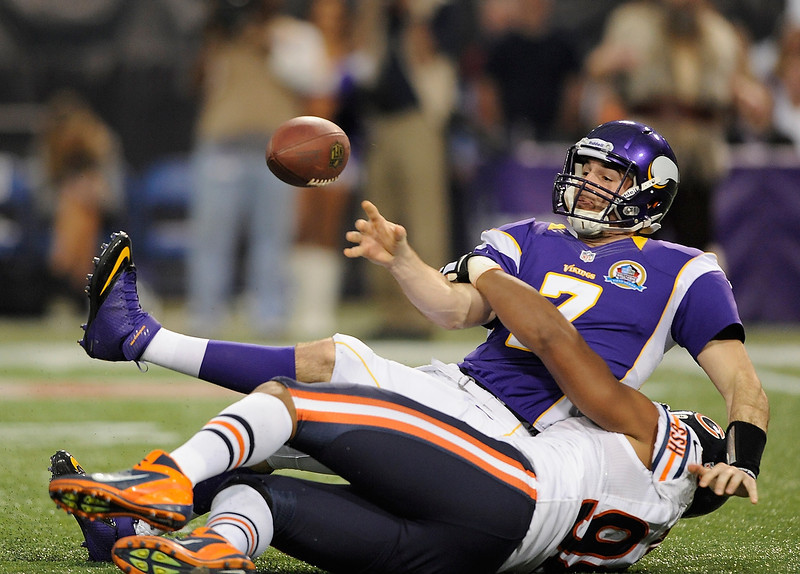 . Corey Wootton #98 of the Chicago Bears sacks Christian Ponder #7 of the Minnesota Vikings during the first quarter of the game on December 9, 2012 at Mall of America Field at the Hubert H. Humphrey Metrodome in Minneapolis, Minnesota. (Photo by Hannah Foslien/Getty Images)