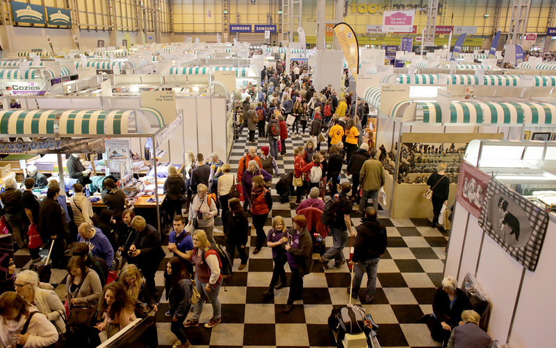 . Visitors walk around the trade stands on the first day of Crufts dog show at the NEC on March 6, 2014 in Birmingham, England. Said to be the largest show of its kind in the world, the annual four-day event, features thousands of dogs, with competitors traveling from countries across the globe to take part. Crufts, which was first held in 1891 and sees thousands of dogs vie for the coveted title of \'Best in Show\'.  (Photo by Matt Cardy/Getty Images)