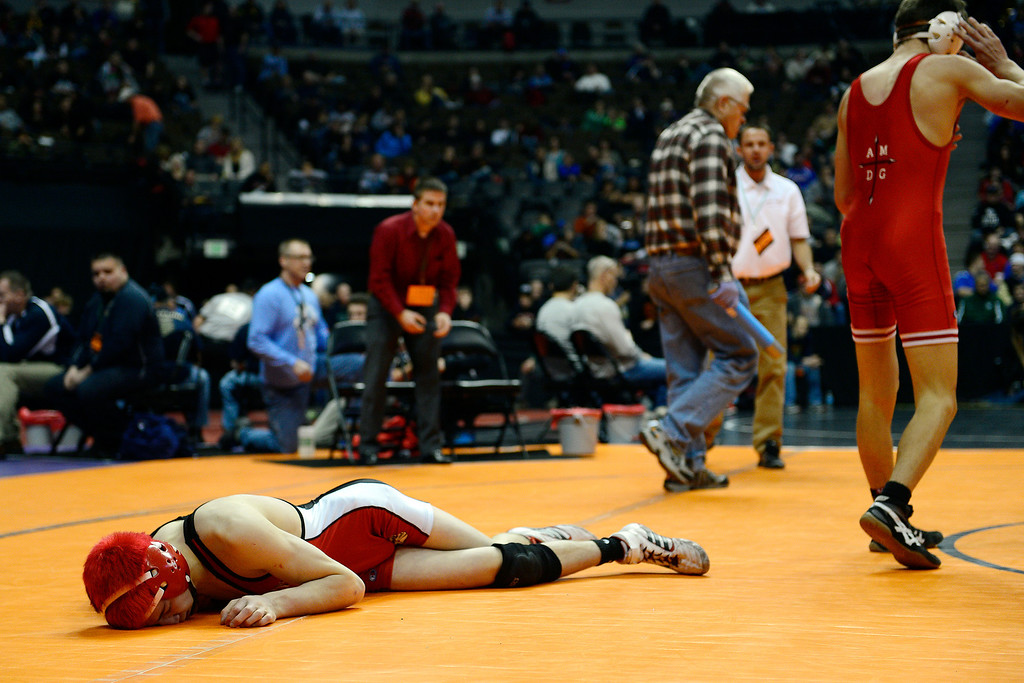 . DENVER, CO - FEBRUARY 21: Brighton\'s Eric Yamaguchi lies on the mat exhausted after giving up an overtime-forcing takedown to Regis Jesuit\'s Josh Redman during the Colorado State High School Wrestling Championships. Redman would win the match 9-7 in sudden death. The state finals will run through Saturday evening at the Pepsi Center. (Photo by AAron Ontiveroz/The Denver Post)