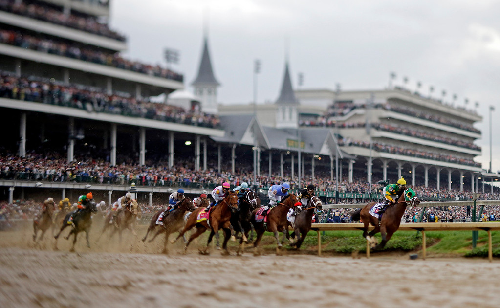 . Horses make their way around turn one during the 139th Kentucky Derby at Churchill Downs Saturday, May 4, 2013, in Louisville, Ky. (AP Photo/Matt Slocum)
