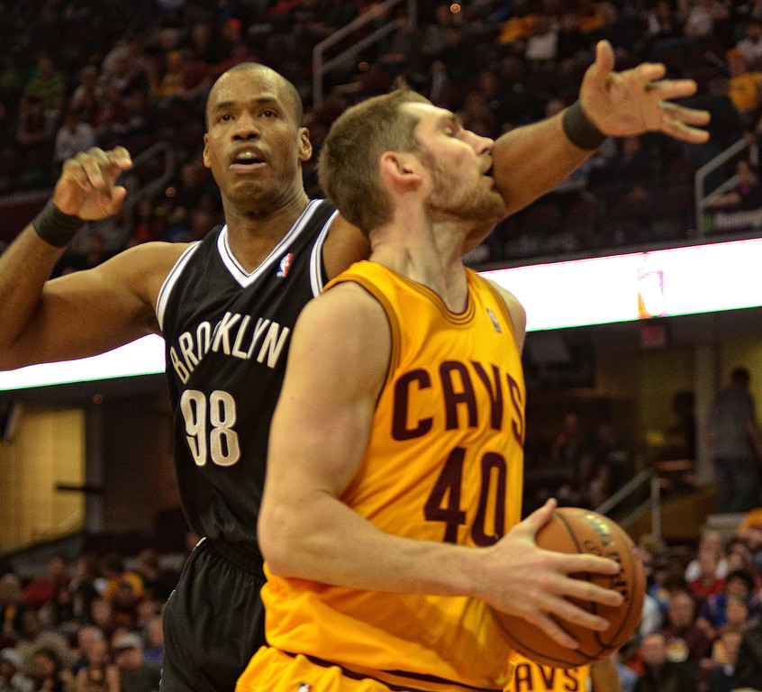 . Michael Allen Blair/Digital First Media Cavs\' center Tyler Zeller gets a stiff arm from the Nets Jason Collins during the fourth quarter of a game April 16 at Quicken Loans Arena.