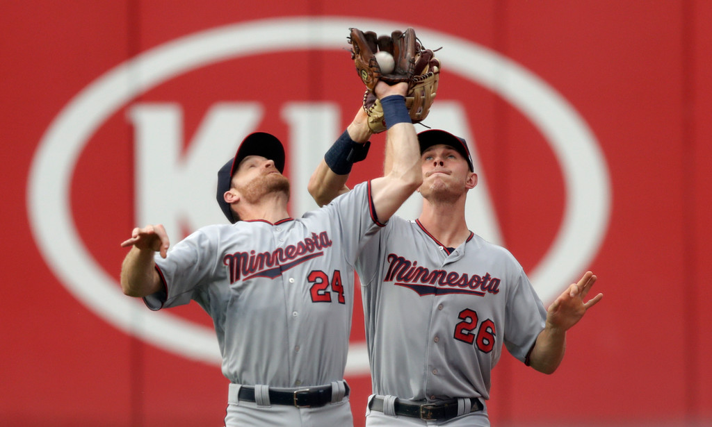 . Minnesota Twins\' Logan Forsythe (24) and Max Kepler (26) collide as Forsythe catches a ball hit by Cleveland Indians\' Jose Ramirez in the first inning of a baseball game, Monday, Aug. 6, 2018, in Cleveland. Ramirez was out on the play. (AP Photo/Tony Dejak)