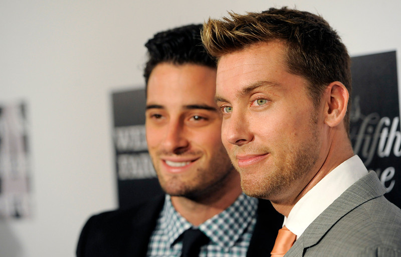 """. Lance Bass, right, poses with his boyfriend Michael Turchin at the L.A. Gay and Lesbian Center\'s \""""An Evening\"""" at the Beverly Wilshire on Thursday, March 21, 2013 in Beverly Hills, Calif. (Photo by Chris Pizzello/Invision/AP)"""