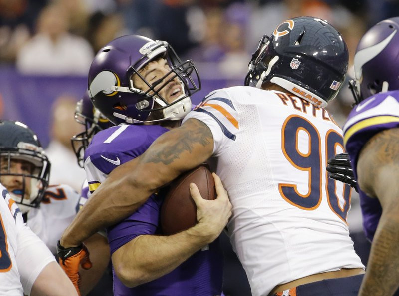 """. <p><b> Minnesota quarterback Christian Ponder was sidelined by a concussion Sunday against Chicago, but the Vikings prevailed when this guy came to the rescue in overtime � </b> <p> A. Matt Cassel <p> B. Adrian Peterson <p> C. Bears coach Marc Trestman <p><b><a href=\'http://www.chicagotribune.com/sports/football/bears/ct-spt-1202-haugh-bears-chicago-20131202,0,4240103.column\' target=\""""_blank\"""">HUH?</a></b> <p>    (AP Photo/Ann Heisenfelt)"""
