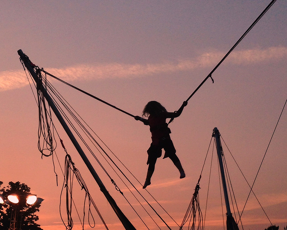 . A fairgoers is silhouetted against the evening sky as they ride one of the midway rides at the Boonville Oneida County Fair on Friday July 25, 2014. JOHN HAEGER-ONEIDA DAILY DISPATCH @ONEIDAPHOTO ON TWITTER
