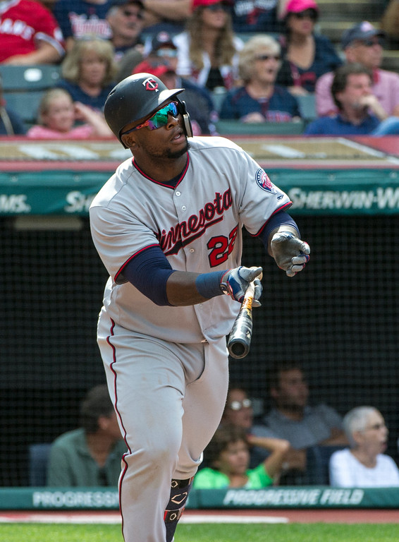 . Minnesota Twins\' Miguel Sano (22) watches his solo home run off Cleveland Indians relief pitcher Brad Hand during the ninth inning of a baseball game in Cleveland, Thursday, Aug. 30, 2018. (AP Photo/Phil Long)
