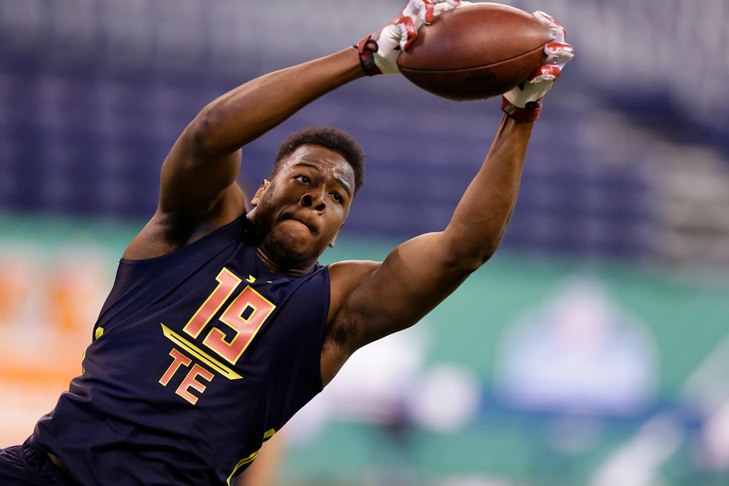 . Arkansas tight end Jeremy Sprinkle runs a drill at the NFL football scouting combine in Indianapolis, Saturday, March 4, 2017. (AP Photo/Michael Conroy)