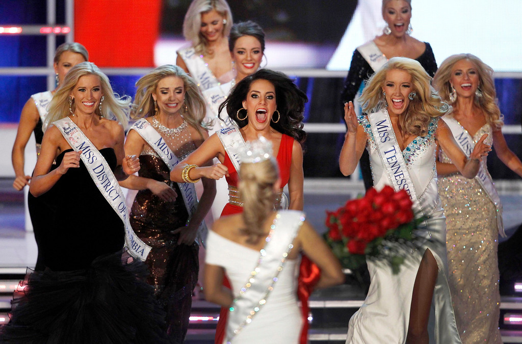 . Contestants rush to congratulate Miss New York Mallory Hytes Hagan (C), 23, after she was crowned Miss America 2013 during the Miss America Pageant in Las Vegas January 12, 2013. REUTERS/Steve Marcus