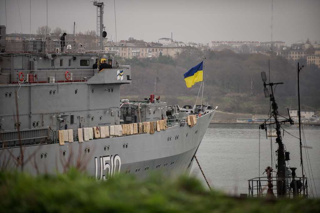 . A Ukrainian national flag flies on the board of  Ukrainian navy ship Slavutich, at harbor of  in Sevastopol, Ukraine, Tuesday, March 4, 2014. Crimea still remained a potential flashpoint. Pro-Russian troops who had taken control of the Belbek air base in Crimea fired warning shots into the air Tuesday as around 300 Ukrainian soldiers, who previously manned the airfield, demanded their jobs back.(AP Photo/Andrew Lubimov)