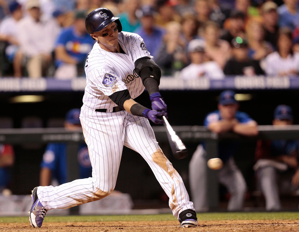 . Colorado Rockies\' Troy Tulowitzki strikes out against the Chicago Cubs in the seventh inning of a baseball game in Denver, Friday, July 19, 2013.(AP Photo/Joe Mahoney)