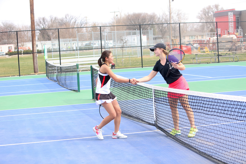 Scottsbluff's Alisha Huyhn shakes hands with Ogallala's Kira Mestl during the Scottsbluff dual on Tuesday