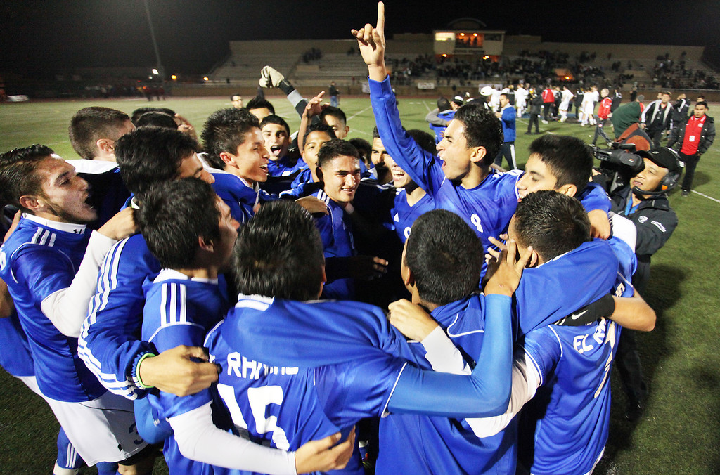 . The El Rancho Dons Boy Soccer Team celebrate after defeating the San Clemente Triton 3-0 in the Division 1 CIF Playoff Tournament, Saturday March 9, 2013 at Warren High School in Downey. (Correspondent photo by Chris Burt/Sports)