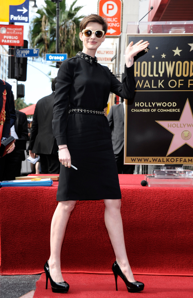 Description of . Actress Anne Hathaway waves to fans at the Hugh Jackman star ceremony at the Hollywood Walk of Fame on Thursday, Dec. 13, 2012, in Los Angeles. (Photo by Dan Steinberg/Invision/AP)
