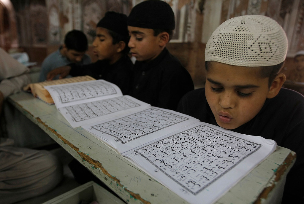 . Pakistani Muslim students attend a religious madrassa, or school, to learn the Quran, in Peshawar, Pakistan, Tuesday, May 17, 2016. Religious schools in Pakistan, most of them in mosques are the only source of education for thousands of children. (AP Photo/Mohammad Sajjad)
