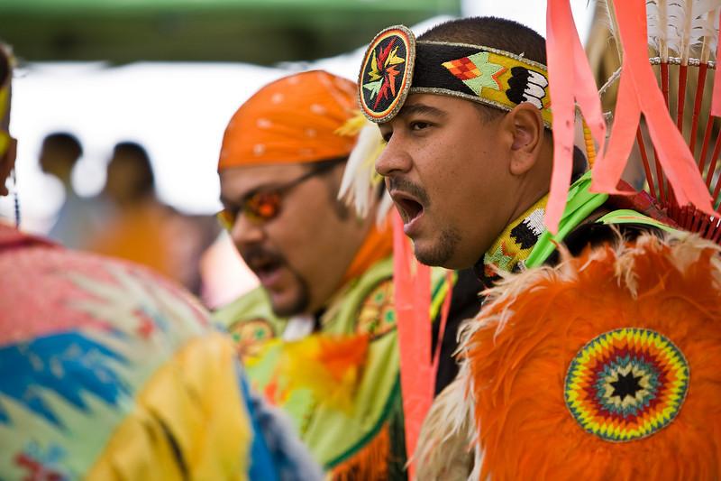 Wayne Dimalanta of Randleman NC sings while playing the tribal drum.