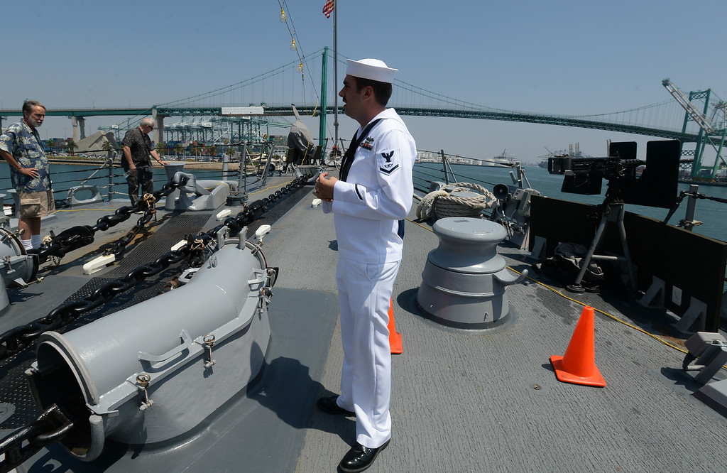 . People take a tour of the USS Spruance, an Arleigh Burke-class guided missile destroyer, which is docked in the Port of Los Angeles for Navy Days.  FC3 Robert Kivett (SW) shows the anchors of the ship. Saturday, August 09, 2014, San Pedro, CA.   Photo by Steve McCrank/Daily Breeze