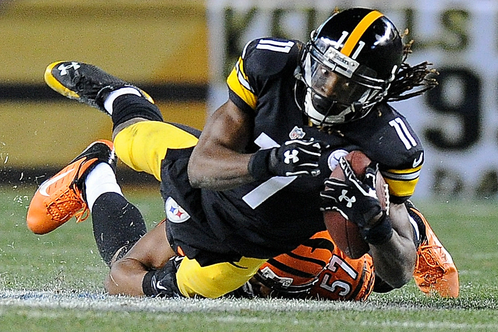 . Pittsburgh Steelers wide receiver Markus Wheaton (11) is hit by Cincinnati Bengals outside linebacker Vincent Rey (57) after making a catch during the second quarter of an NFL football game, Sunday, Dec. 28, 2014, in Pittsburgh. (AP Photo/Don Wright)