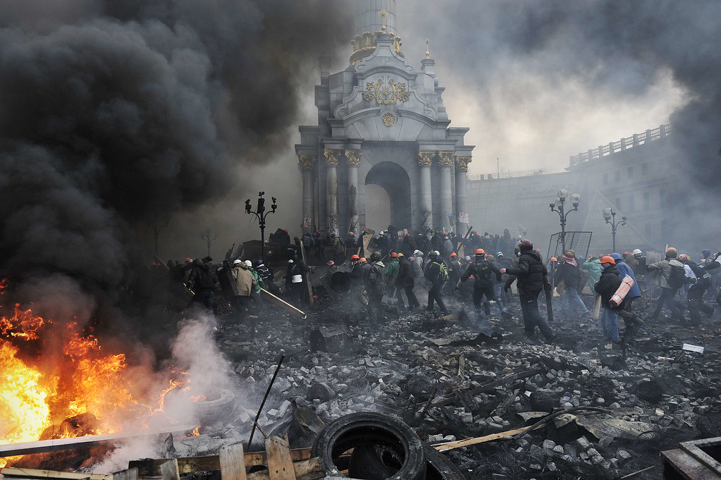 . Protesters advance towards new positions in Kiev on February 20, 2014.  AFP PHOTO / LOUISA  GOULIAMAKI/AFP/Getty Images