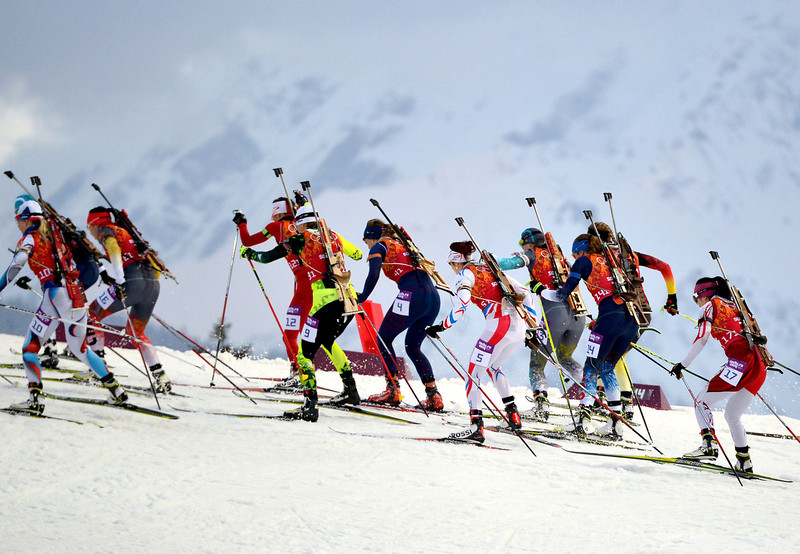 . Athletes compete at the start of the Women\'s Biathlon 4x6 km Relay at the Laura Cross-Country Ski and Biathlon Center during the Sochi Winter Olympics on February 21, 2014, in Rosa Khutor, near Sochi. (ALBERTO PIZZOLI/AFP/Getty Images)