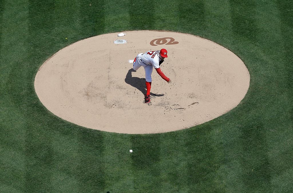 . Pitcher Stephen Strasburg #37 of the Washington Nationals throws to a Miami Marlins batter during the first inning of their opening day game at Nationals Park on April 1, 2013 in Washington, DC.  (Photo by Rob Carr/Getty Images)