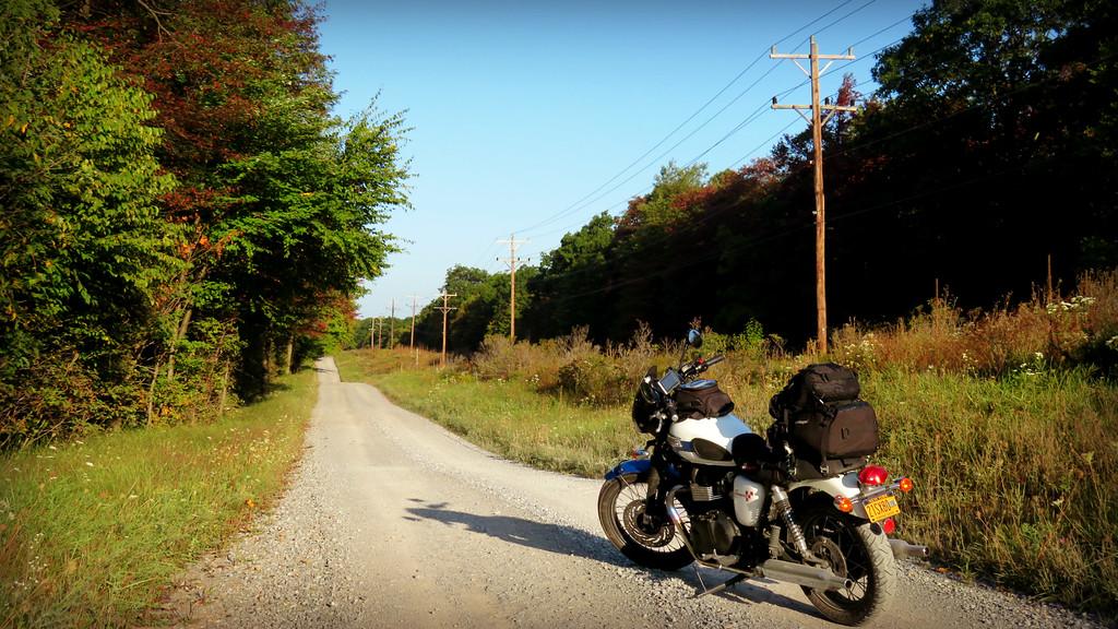 triumph bonneville on a dirt road