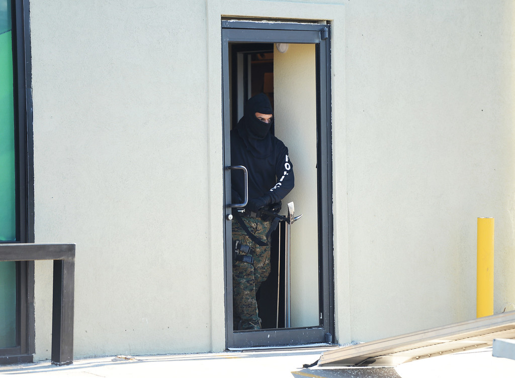 . Drug Enforcement Agency officials raids VIP Cannabis, located at 2949 W. Alameda Ave., April 30, 2014. The marijuana dispensary was previously raided in November 2013. (Photo by RJ Sangosti/The Denver Post)