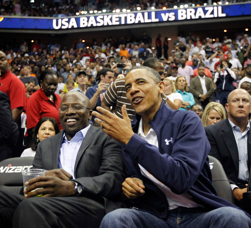 . President Barack Obama, right, talks with his former personal aide Reggie Love, left, as they attend an Olympic men�s exhibition basketball game between Brazil and Team USA in Washington, Monday, July 16, 2012. (AP Photo/Pablo Martinez Monsivais)