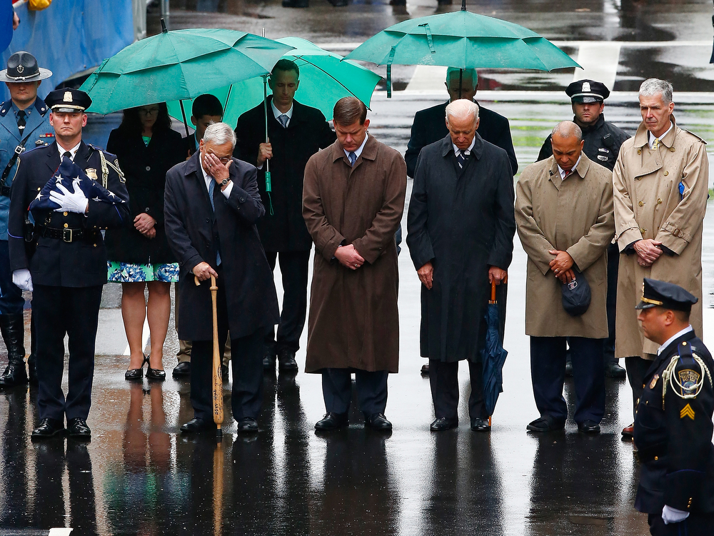 . (L-R) Former Boston mayor Thomas Menino, mayor Marty Walsh, U.S. Vice President Joe Biden, Governor Deval Patrick, and Tom Grilk, Executive Director, Boston Athletic Association stand together during the flag raising ceremony commemorating the one-year anniversary of the Boston Marathon bombings on Boylston Street near the finish line on April 15, 2014 in Boston, Massachusetts.  Last year, two pressure cooker bombs killed three and injured an estimated 264 others during the Boston marathon, on April 15, 2013.  (Photo by Jared Wickerham/Getty Images)