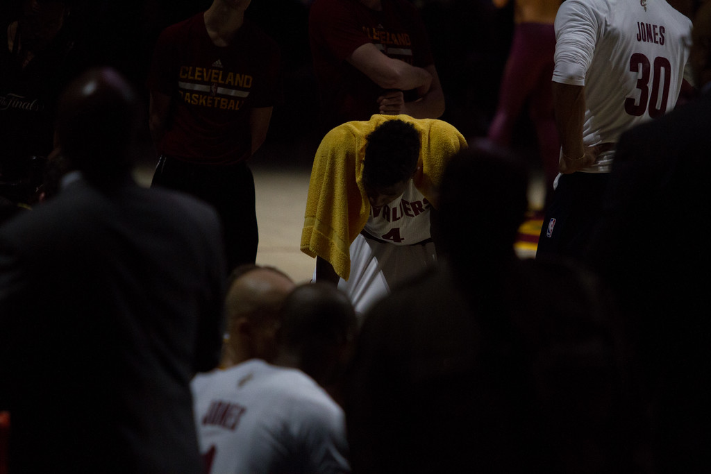 . Iman Shumpert of the Cleveland Cavaliers bends over during a timeout in game 4 of the NBA Finals against the Golden State Warriors at the Quicken Loans Arena on June 10, 2017.  The Cavs defeated the Warriors 137-116.