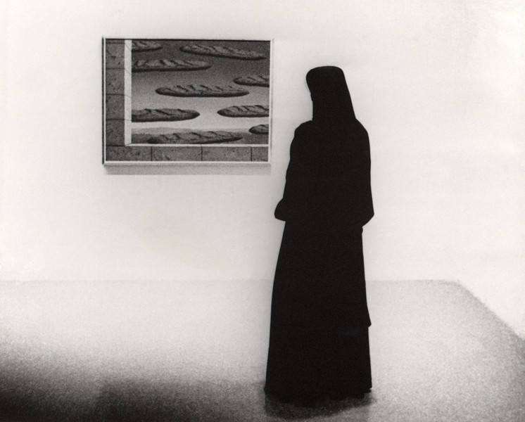 """Nun observing levitating baguette (""""The Golden Legend"""" by René Magritte painting) at New York Museum of Modern Art (NYMOMA)"""