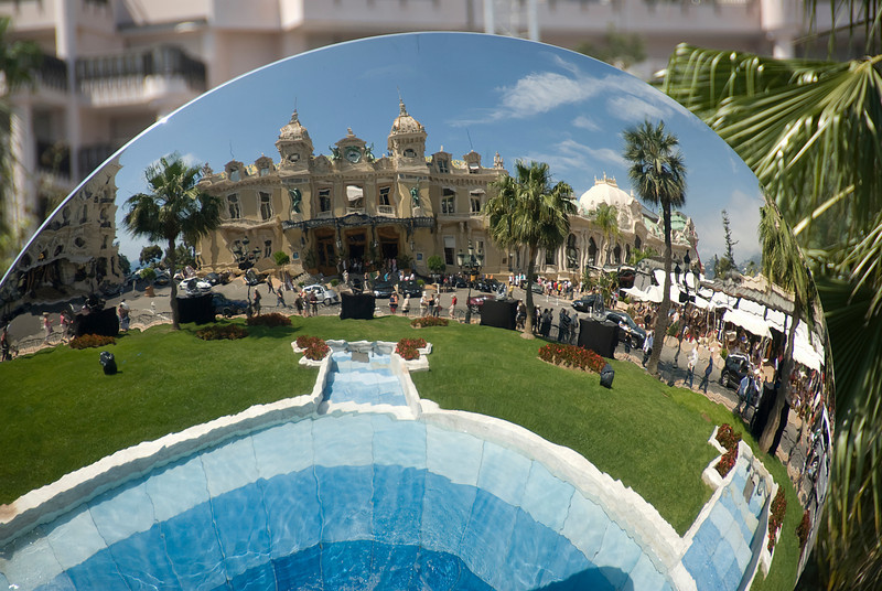 Reflection of the Casino Monte Carlo from the glass ball at the Casino Square Garden